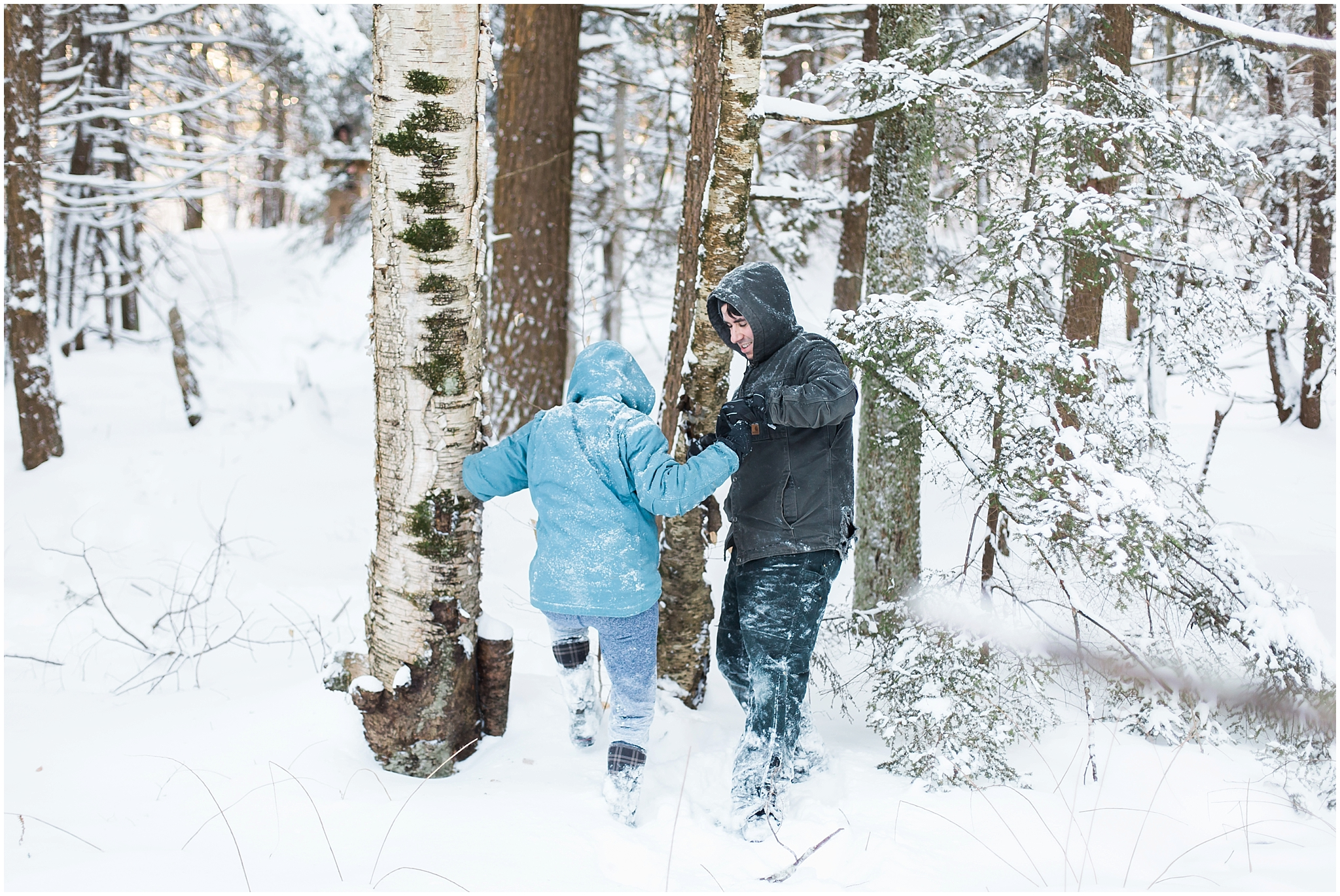 canada winter forrest. two people hiking